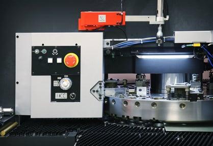 CNC punching machine with metal sheet