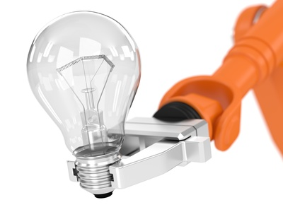 Robotic arm holding light bulb