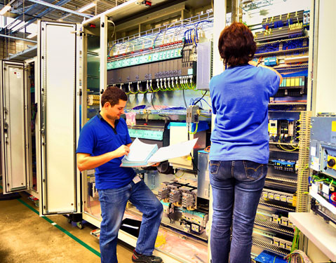 workers-industrial-control-panel-plc